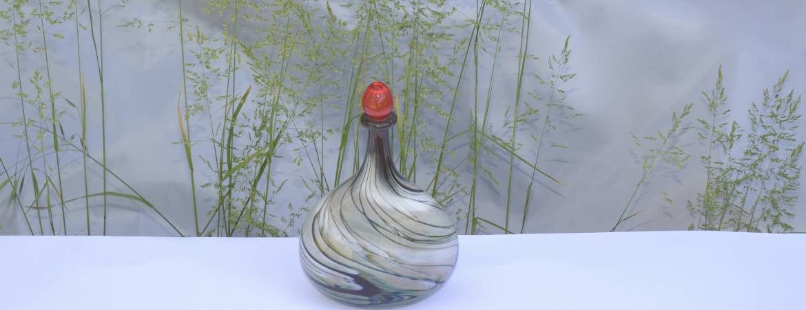 Siddy Langley Cream and Red stoppered Oval Flask in front of grasses
