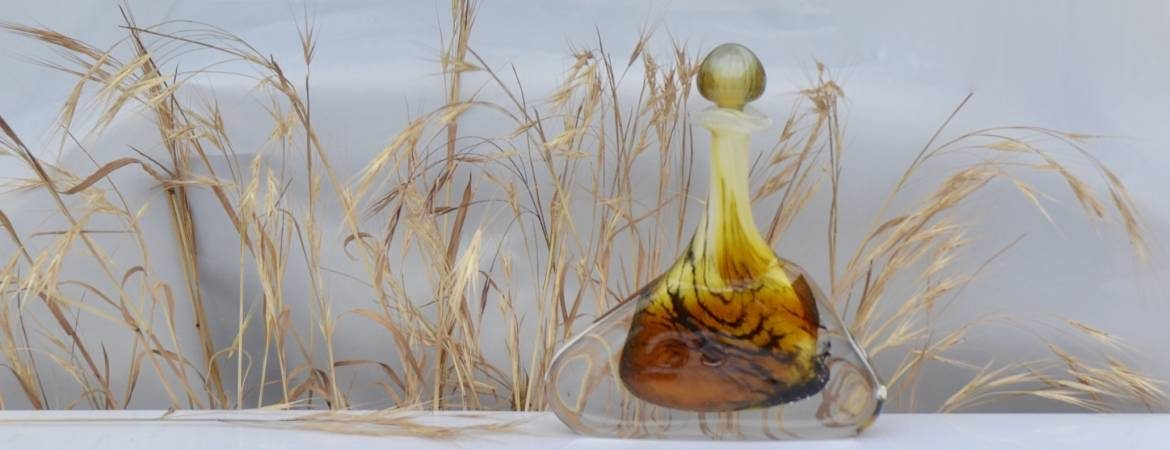 Tiger, Tiger scent bottle against a background of dried grasses