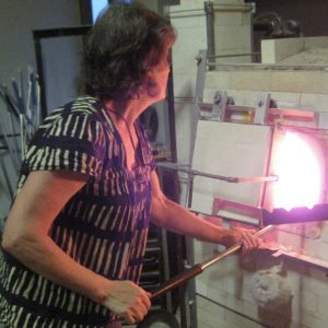 Siddy Langley gathering molten glass from the furnace